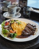 """Omu Rice"" & Angus Beef Steak Plate with Salad ($18.80++) ."