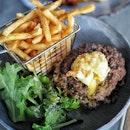 @olabeachclubsg Loco Moco, Wagyu patties, Kombu rice, panko egg, fries and salad.