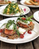 Rösti with Smoked Salmon & Poached eggs $18++ Timely poached eggs with smoked salmon, fresh rockets & sun-dried tomatoes resting on a sheet of potato nest.