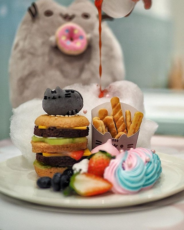 Pusheen Double Delight Fruitcake Burger ($17.90) Super-stacked fruitcake burger with Pusheen macaron, biscuit fries, 'ketchup' meringue kiss, fresh cream with berries and fluffy cotton candy .
