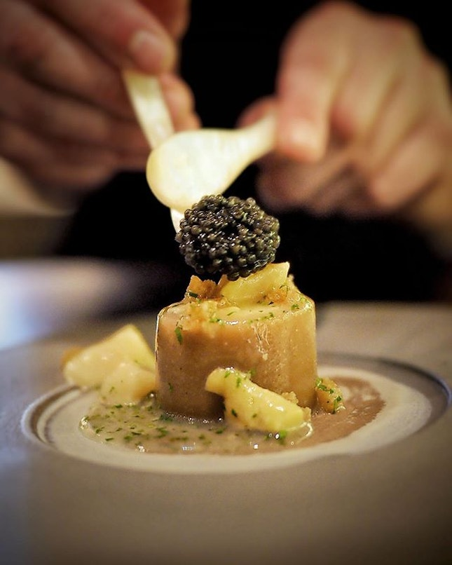 """One of the Signature dish at @restaurant.table65 """"Os a moelle"""", smoked herring bone, veal tartare with bone marrow, cockles and Beluga caviar ."""