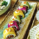 Fruitti Autumn Roll ($13.80) from @sushiteisg Sushi rolls of baby octopus with cucumber wrapped in a colourful rainbow of mango, avocado and dragonfruit, topped with cream cheese and ikura.