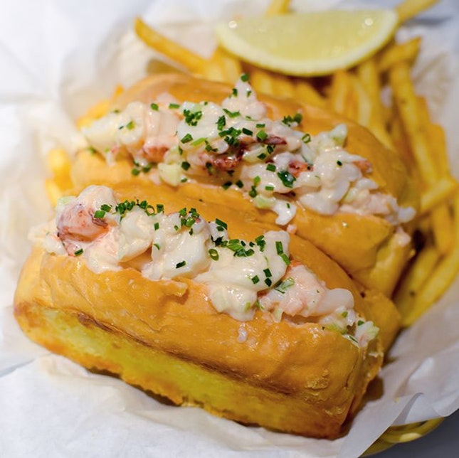 Lobster roll [$29.90++] Served with a huge heap of shoestring fries, each butter brioche roll comes with fresh slipper lobster chunks snuggled between and topped with chives.