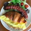 Truffle eggs crossaint [$12.50] + Beef sausage [+$6] .