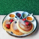 Pancakes with three different types of honey dips and strawberry compote ($17.90++).
