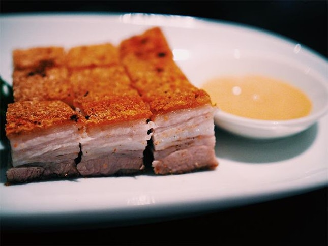 Wan Hao's roast pork belly may look average but it tastes absolutely incredible.