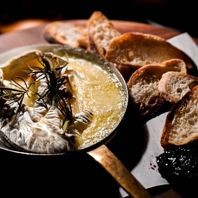 Melted Camembert cheese served with a toast and jam at Orgin Bar.