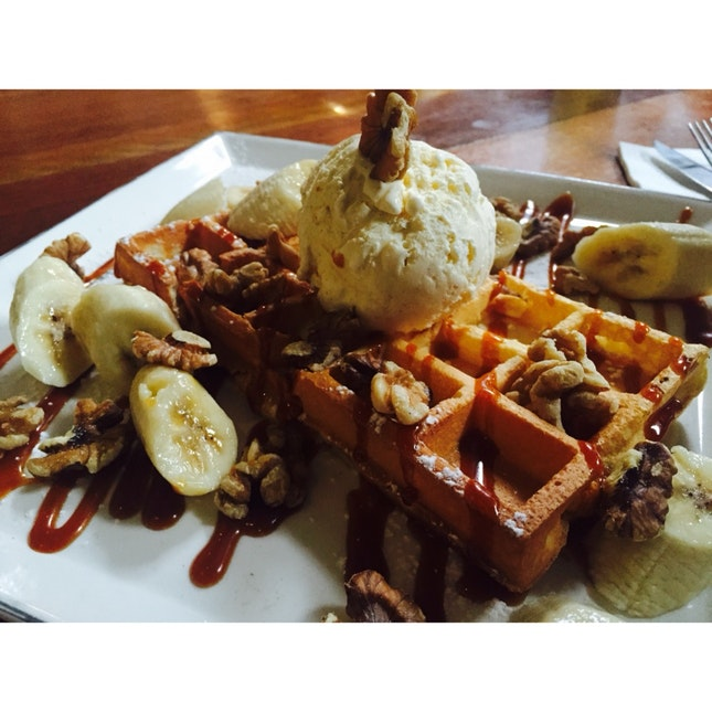 Homemade Buttermilk Waffle With Vanilla Ice Cream, Bananas, Caramel Sauce And Nuts.