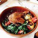 Duck confit with raspberry sauce.