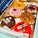 Pretty donuts in a limited edition christmas metal tin!