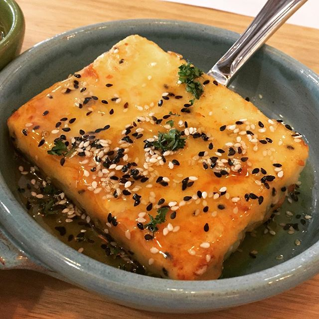 Feta Saganaki ($16.90) 🧀 Pan fried feta cheese dressed with honey & sesame 🍯 I love the crispy thin layer of honey coating the soft cheese.