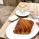 Un croissant (pronounced kwah-sont) et café pour moi.