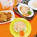 Comparing chicken rice at Maxwell food centre.