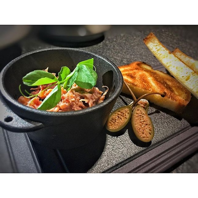 Entree of Duck Rillette with Broiche and Caper Berries.