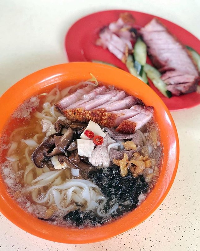 Enjoying the silky smooth Kueh Teow from Lai Heng topped with some crispy roasted pork from the next stall.