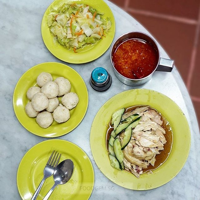 Special set for two with a plate of chicken, ten chicken rice balls and cabbage.