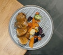 Oven roasted thyme chicken thigh served with honey roasted roots & seasonal vegetables in chicken garlic sauce.