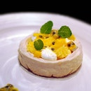 Sweet and tangy pavolo with yuzu, mango and passionfruit set on a cookie base with a delightful crunch.