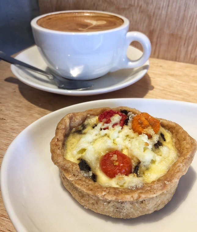 Mushroom, Caramelised Onion, Tomato, Chive and Cheddar Quiche ($5) & Flat White ($5)
