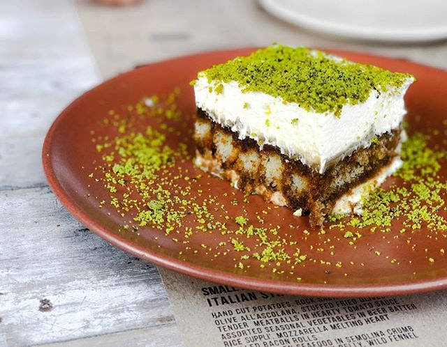 "iO Italian Osteria @italianosteriasg - i Dolci/Desserts - Pistachio Tiramisu (💵S$14) 🥄 • ACAMASEATS & GTK💮: Tiramisu which means ""Pick Me Up"" normally is made up off Ladyfingers dipped in Coffee & Alcohol, layered with a whipped eggs, sugar & marscarpone cheese flavoured with Cocoa."