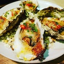 Chilli padi giving these grilled oysters an extra kick!