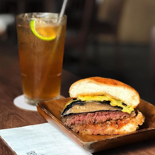 Fun Boy Three [S$23.00] Ice Earl Grey Tea [S$6.00] ・ 150g Black Angus Beef Patty | Smoked Applewood Cheddar | Roasted Portobello Mushroom | Garlic & Miso Butter | Double Ketchup | Truffle Aioli | Toast Brioche Bun ・ Finally tried @PotatoHead burger after an extremely long contemplation.