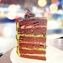 Matcha Chocolate Cake [S$12.50/slice] ・ Delicate matcha cream cheese paired with raspberry cream, chocolate cake and topped with chocolate glaze.