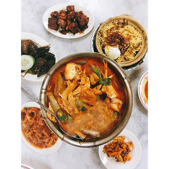 Bubbling bowl of curry fish head for the wet season | All my fav dishes - grilled lamb, sambal squid & lamb biryani 😍  #burpple