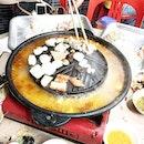 Mookata with tom yum soup base.