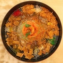 Tossing yusheng symbolises prosperity and good luck for the new year ahead.