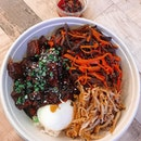 Five Spice Pork Bowl — Koshikari rice served with a mix of pork belly and pork collar, dashi infused black fungus and carrots, and onsen eggs.