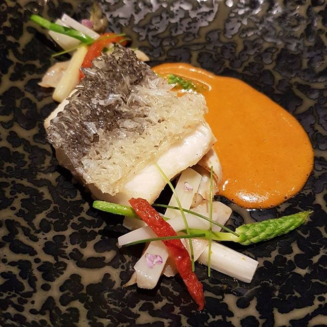 "New Zealand blue cod ""crispy scales""  Mirugai, white asparagus, coconut, tomato, curry  No clue on how they made the skin so crispy that it's spiky yet the meat underneath fully retaining its moisture and soft texture..impressed by the culinary skills displayed  And white asparagus is much better tasting than regular ones  #burpple #cornerhouse #botanicgardens #michelinstar #finedining #bluecod #sgeats #sgrestaurants #eatingout #foodie #sgfoodie #fooddiary #foodporn #foodgasm #instafood #foodstagram"