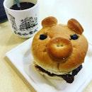 Pork chop bun + kopi breakfast.