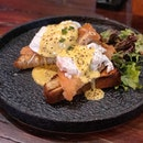 Rise and shine with a delicious plate of Eggs Benedict on smoked salmon and toast.