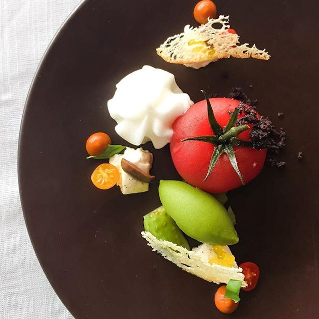 Heirloom tomato with fresh burrata, olives, basil sorbet, foam and pesto.