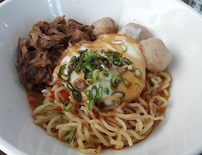 TheSpicy Mee(SGD$12.00) with pulled pork, pork balls, homemade sambal chilli, sesame seeds, pork lard and signature 72 degree onsen tamago egg.