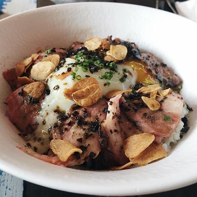 A comfort food bowl with rice, tender short rib, onsen egg, garlic chips, all perfumed with truffle.