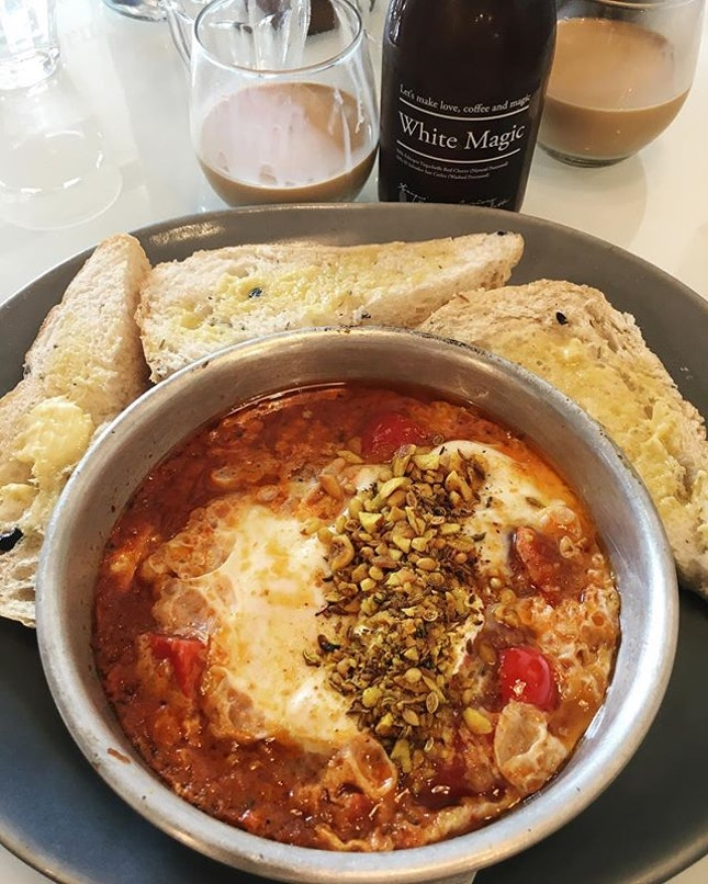 Spicy baked eggs S$15.50 White magic S$6.90  Unplanned brunch.