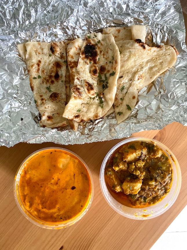 Butter Chicken ($14.90), Aloo Gobi ($11.90), Garlic Naan ($5), Plain Naan ($3.50)