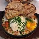 Baked eggs, chick pea stew & chorizo