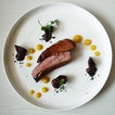 Pekin duck breast, orange purée, beetroot and Valrhona dark chocolate sauce.