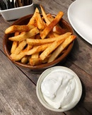 Can never go wrong with fries, especially when they are dusted with paprika and served with a garlicky dip.