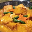 Homemade tofu in pumpkin sauce.
