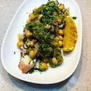 Octopus that's been grilled to the right texture, served with chickpeas and an amazing salsa verde!