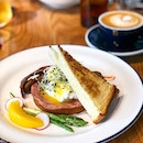 Bb Benedict ($15) and latte  2 poached eggs, char honey pork belly, honey baked ham homemade hollandaise, brioche.