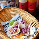 Tacos de pescado ($13 for 2)  Grilled white dory, fresh cabbage, and smoked chipotle aioli on a flour tortilla.