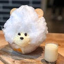 Shaved ice (Shiro Kuma) ($9.80)  Hokkaido shaved ice in the shape of a bear, served with vanilla ice cream, orange, mango, white peach, strawberry, with Hokkaido BIEI Jersey milk syrup.