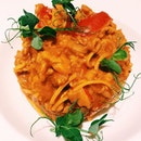 Tagliolini with crab and pachino tomatoes.
