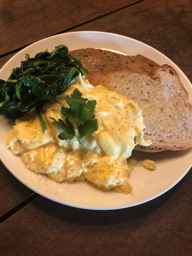 Scrambled Eggs On Toast add on wilted spinach ($11 + $3.50)