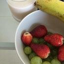 #breakfast grapes, strawberries, banana, Pure Harvest organic rice milk